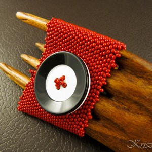 http://krisztaline.com/715-thickbox_default/vinyl-record-button-armband.jpg