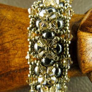 http://krisztaline.com/793-thickbox_default/my-new-love-in-gray-bracelet.jpg