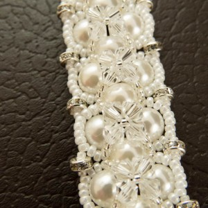 http://krisztaline.com/949-thickbox_default/pearl-and-crystal-love-bracelet.jpg